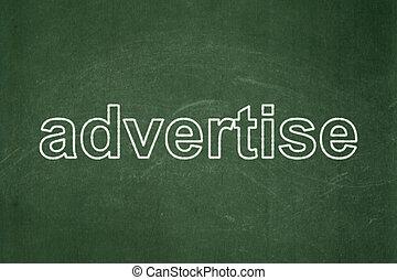 Marketing concept: Advertise on chalkboard background