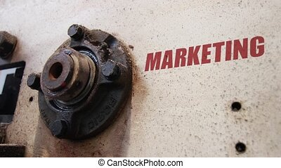 Marketing conceptual metaphor - Machine wheels rotating with...