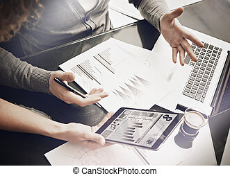 Marketing department working process.Photo woman showing business reports modern tablet.Statistics graphics screen.Banker holding pen for signs documents,discussion startup idea.Horizontal.Film effect