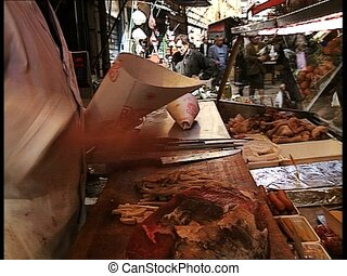 MARKETPLACE man selling beef tripe - Man selling beef tripe...