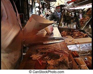 MARKETPLACE man selling beef tripe