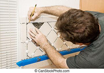 Marking Ceramic Tile - Tile setter marking ceramic tiles for...