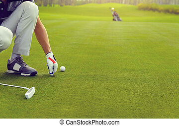 Marking golf ball position on the green