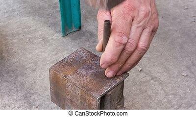 marking holes in a metal workpiece
