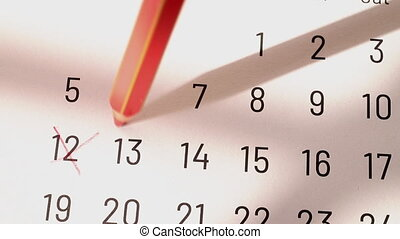 Marking numbers on calendar with pencil