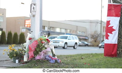 Marking Police Officer Death - A roadside memorial marks the...