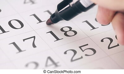 Marking the eighteenth 18 day of a month in the calendar...