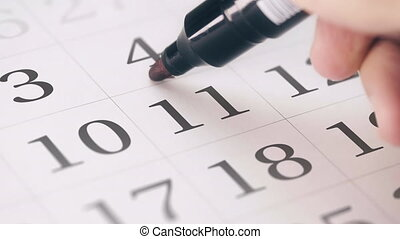 Marking the eleventh 11 day of a month in the calendar with...