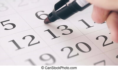 Marking the thirteenth 13 day of a month in the calendar...