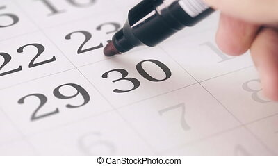 Marking the thirtieth 30 day of a month in the calendar with...
