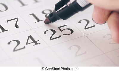 Marking the twenty-fifth 25 day of a month in the calendar...