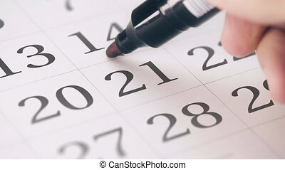 Marking the twenty-first 21 day of a month in the calendar...