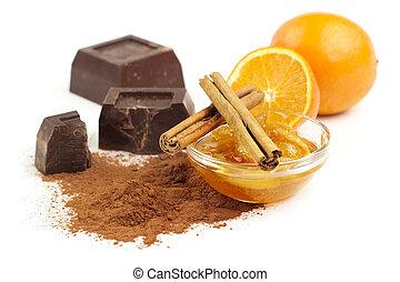 marmalade, cinnamon and chocolate on white background