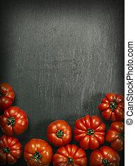 Marmande tomatoes on slate background