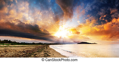 Beautiful panorama of the coastline of Maroantsetra in Madagascar at sunrise, with a dramatic sky and cloudscape