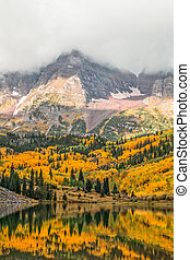 the maroon bells aspen colorado during a storm in fall