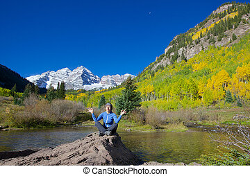 Maroon Bells Meditation - a girl meditating below scenic ...