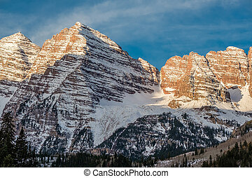 Maroon Bells mountains in snow in Colorado