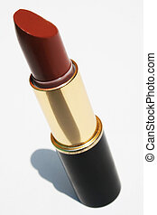 Maroon lipstick - Tube of maroon lipstick against white...
