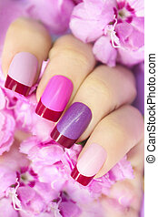 Maroon pink multicolored French manicure.