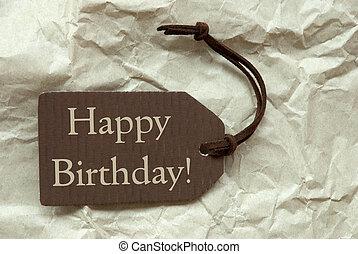 marrón, etiqueta, con, feliz cumpleaños, papel, plano de fondo