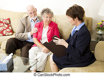 Marriage Counseling - Senior couple meets with a marriage...