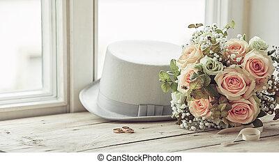 Marriage day composition of hat, rings and bouquet