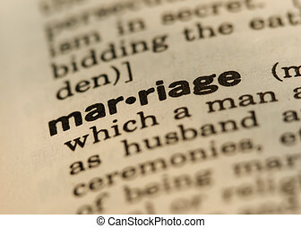 Marriage Definition Close up from old Dictionary, Shot with Yellow Photo Filter