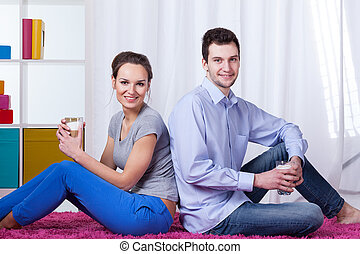 Marriage drinking coffee at home