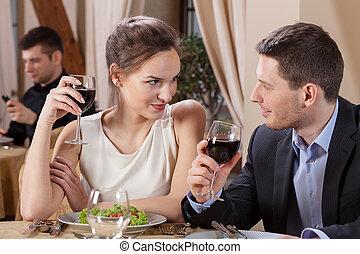 Marriage having dinner in restaurant