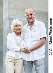 Marriage holding hands - Photo of smiling senior marriage...
