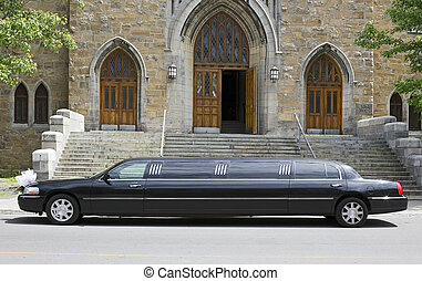 marriage limousine in front of a church