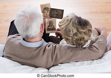 Marriage looking at photos - Senior marriage sitting on the...