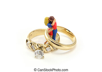 Marriage or relationship concept - A miniature couple is...