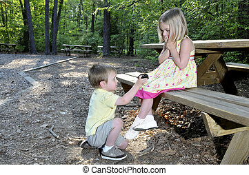 Marriage Proposal - A little boy proposing marriage to a...