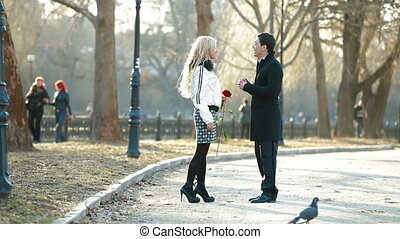 Marriage Proposal - Young man proposing to a woman