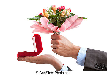 Marriage proposal with ring and flowers