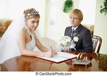 Marriage registration in a solemn hall - signature