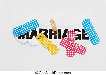 Marriage repair abstract - marriage word with bandages of...