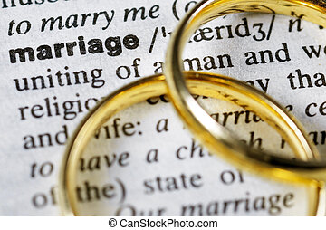 """Marriage - Two wedding rings next to the word """"marriage"""" on..."""