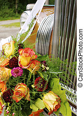 Marriage - with flowers decorated oldtimer car at marriage