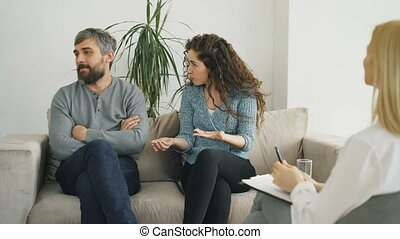 Married couple arguing and quarreling during visit...