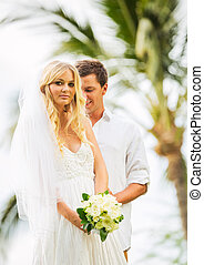 Married couple, bride and groom getting married, Tropical wedding