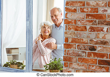 Married couple by the window