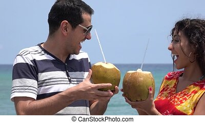 Married Couple Drinking Tropical Fruit Drinks