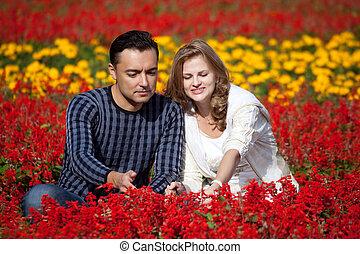 married couple in flowering park