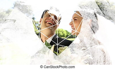 Animation of a just married Caucasian couple on a motorbike seen through a white heart shape window in the foreground