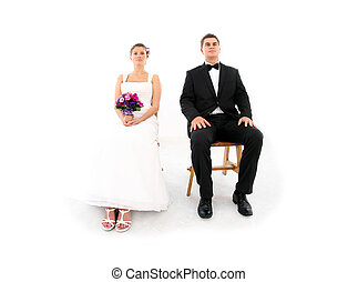 Married couple sitting over white background