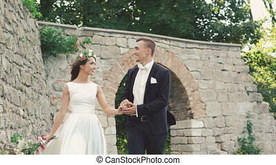 Married couple walking together near the castle. Slowly