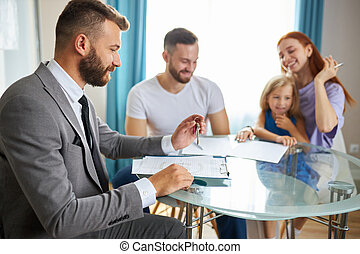 married couple with child girl going to sign the documents for getting their first apartment